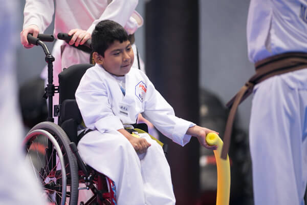 Inspiring-Possibilities-martial-arts-special-needs-boy-in-wheel-chair