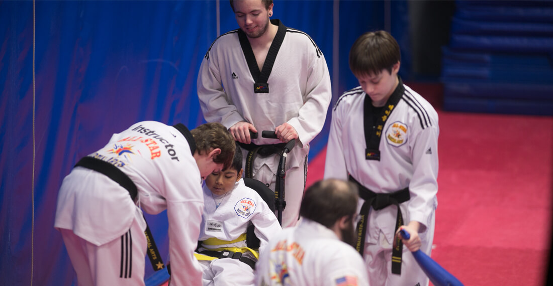 Inspiring-Possibilities-martial-arts-special-needs-slider-_0001_group-helping