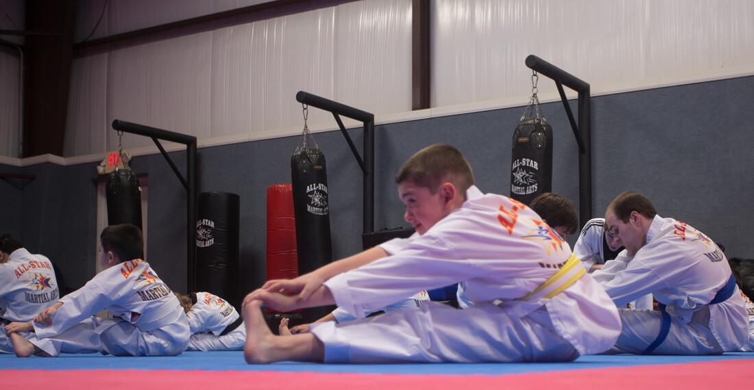 Inspiring-Possibilities-martial-arts-special-needs-slider-_0002_boy-stretching
