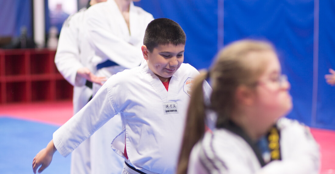 Inspiring-Possibilities-martial-arts-special-needs-slider-_0003_boy-smiling