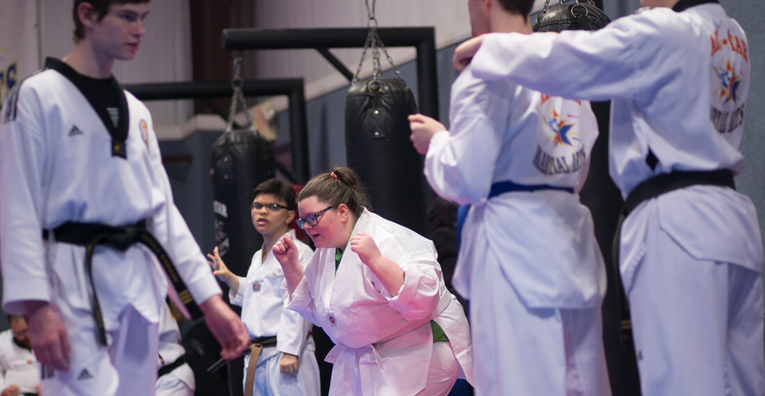 Inspiring-Possibilities-martial-arts-special-needs-slider-_0004_girl-celebrating