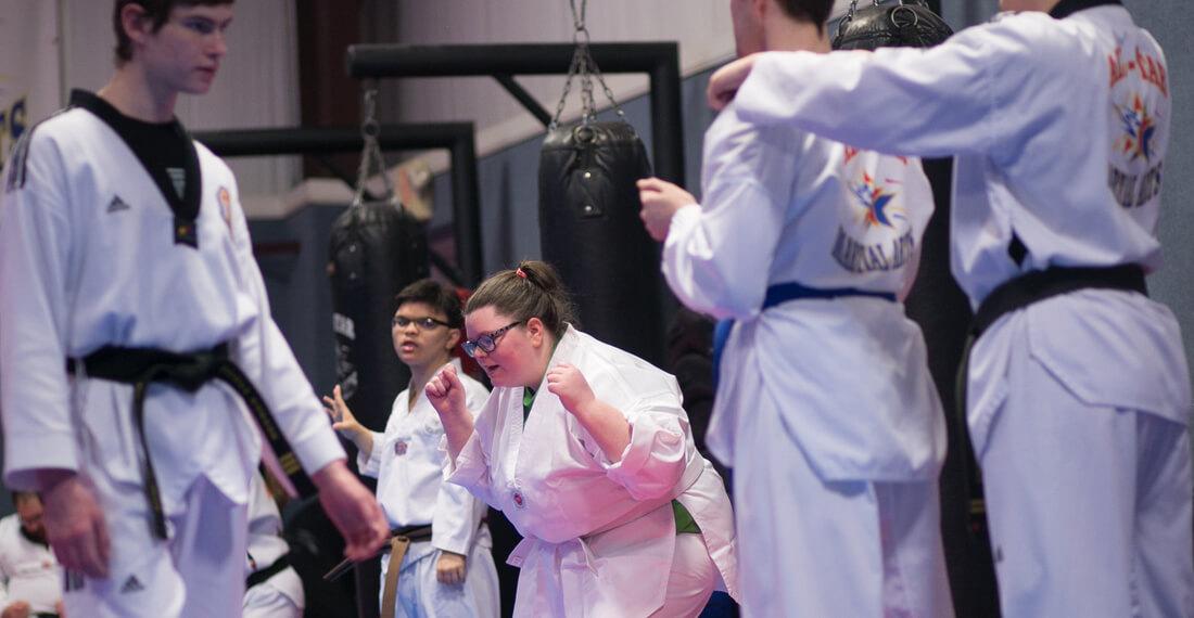Inspiring-Possibilities-martial-arts-special-needs-slider-_0004_girl-celebrating